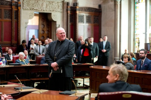 Cardinal Dolan being honored by Senate after delivering opening prayer of session Jan. 6, 2016.