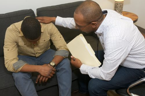 Catholic Charities social worker comforts client
